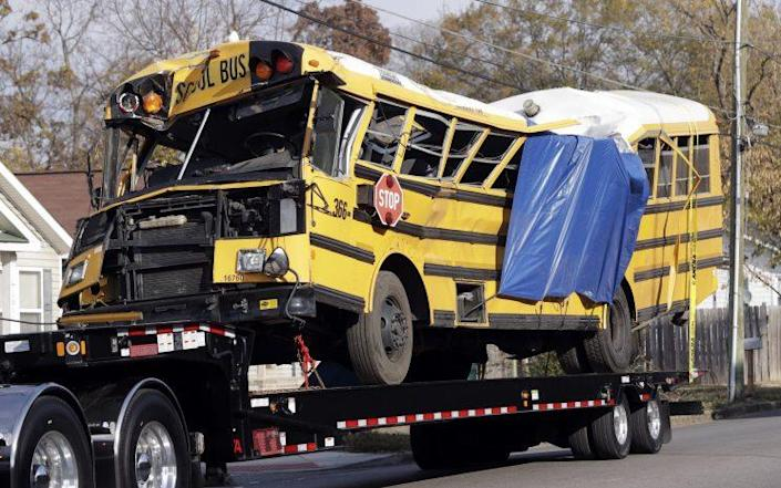 A school bus is carried away Tuesday, Nov. 22, 2016, in Chattanooga, Tenn, from the site where it crashed Monday, Nov. 21. (Photo: Mark Humphrey/AP)