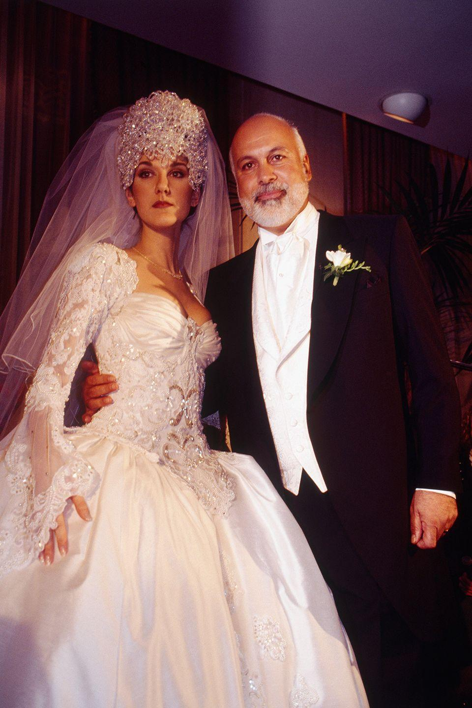 <p>Celine Dion wore an iconic ball gown with a 20-foot train to marry her manager, René Angélil. She accessorized with a headpiece that sparkled with 2,000 Austrian crystals. My heart will go on!</p>