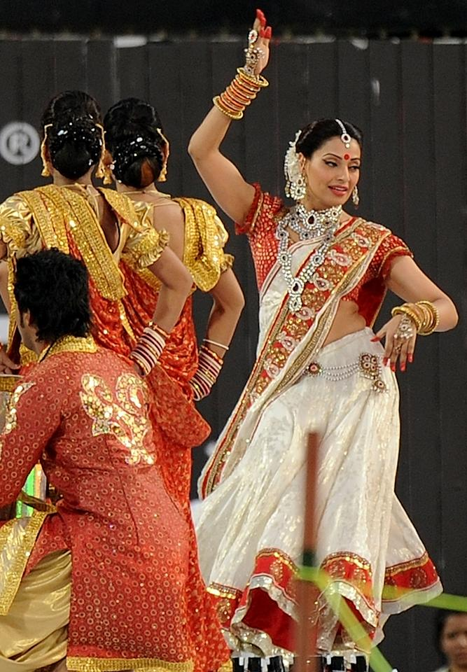 Bollywood actress Bipasha Basu (R) performs during a ceremony before the IPL Twenty20 cricket match between Pune Warriors India and Kings XI Punjab at The Subrata Roy Sahara Stadium in Pune on April 8, 2012.