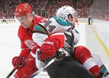 Valtteri Filppula and the Red Wings are headed in one direction while Marc-Edouard Vlasic and the Sharks appear heading opposite