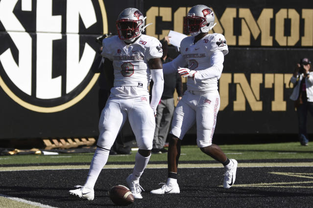 UNLV running back Charles Williams (8) celebrates a touchdown against Vanderbilt along with receiver Mekhi Stevenson (2) in the first half of an NCAA college football game Saturday, Oct. 12, 2019, in Nashville, Tenn. (AP Photo/Mike Strasinger)