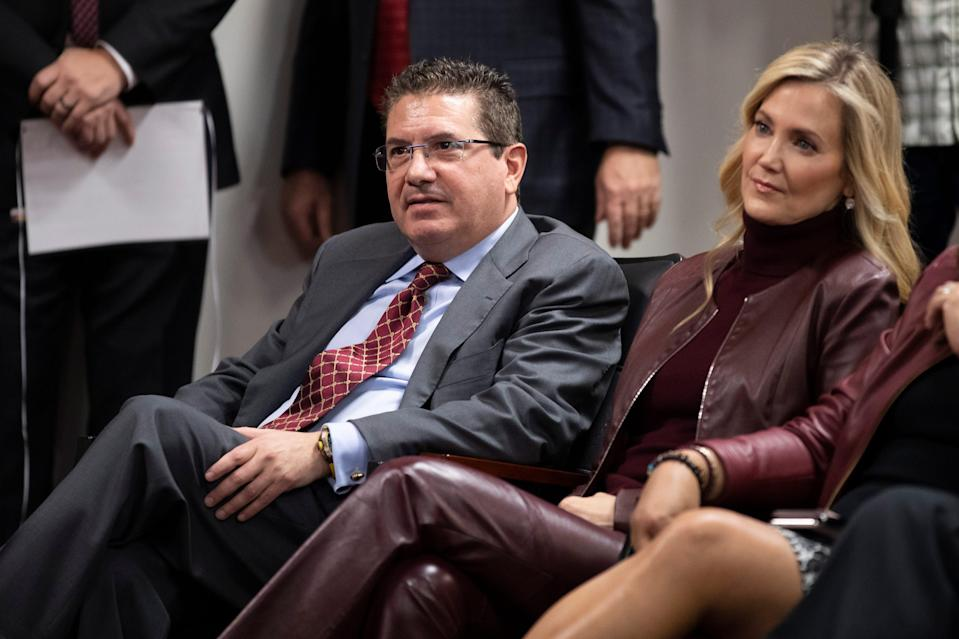 Washington Football Team owner Dan Snyder, left, and his wife Tanya Snyder, listen to head coach Ron Rivera during a news conference at the team's NFL football training facility in Ashburn, Va., in this Thursday, Jan. 2, 2020, file photo.