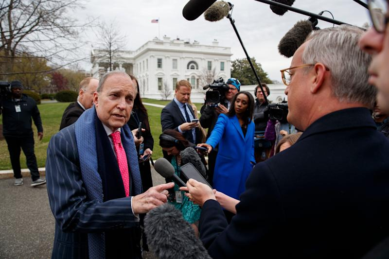 White House chief economic adviser Larry Kudlow talks to reporters outside the White House.