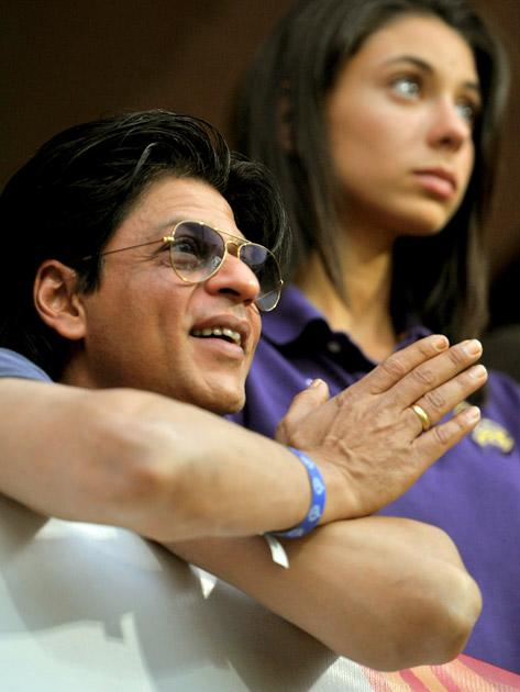 Bollywood actor and owner of Kolkata Knight Riders team Shah Rukh Khan watches the match during the IPL Twenty20 cricket match between Royal Challengers Bangalore and Kolkata Knight Riders at the M. Chinnaswamy Stadium in Bangalore on April 10, 2012. AFP PHOTO/Manjunath KIRAN (Photo credit should read Manjunath Kiran/AFP/Getty Images)