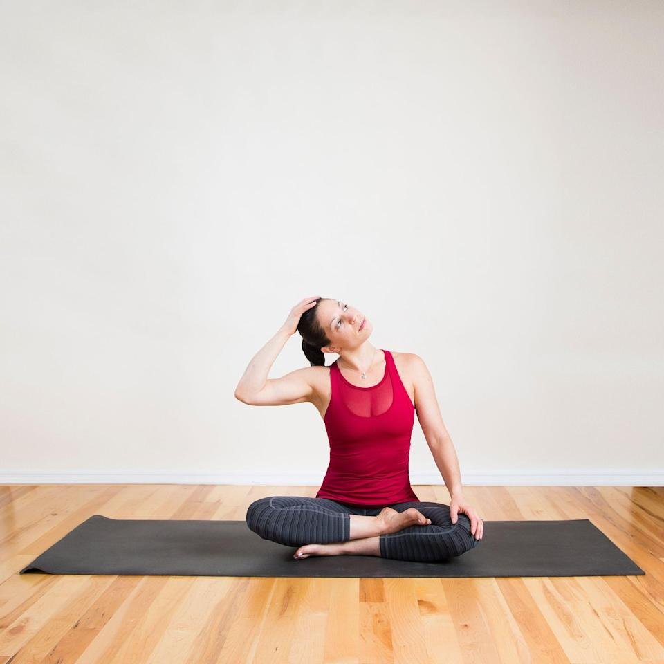 <ul> <li>Sit on the bed in a cross-legged position. Rest your left hand on your left thigh or knee.</li> <li> Place your right hand on the top of your head and slowly tilt your head to the right. Apply gentle pressure with your hand to increase the stretch.</li> <li>Gaze into the left corners of the eyes, holding for 30 seconds. </li> <li>Release and repeat on the left side. Feel free to repeat on each side two or three times.</li> </ul>