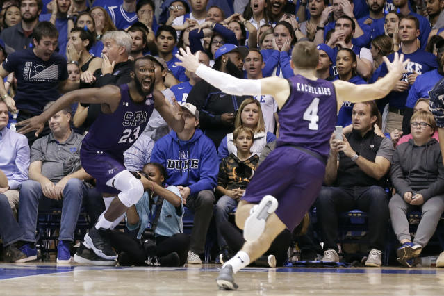 Stephen F. Austin forward Nathan Bain made a basket at the buzzer to beat Duke, and fans are thanking him by donating to his family's post-hurricane GoFundMe. (AP Photo/Gerry Broome)