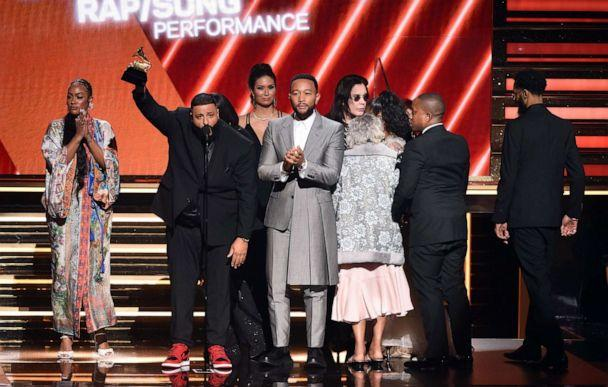 PHOTO: Samantha Smith, DJ Khaled, and John Legend accept the Best Rap/Sung Performance award for 'Higher' onstage during the 62nd Annual GRAMMY Awards at STAPLES Center on Jan. 26, 2020 in Los Angeles. (Kevin Winter/Getty Images)