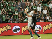 Austin FC forward Danny Hoesen, left, fights for the ball with LA Galaxy defender Daniel Steres, right, during the first half of an MLS soccer match, Sunday, Sept. 26, 2021, in Austin, Texas. (AP Photo/Michael Thomas)