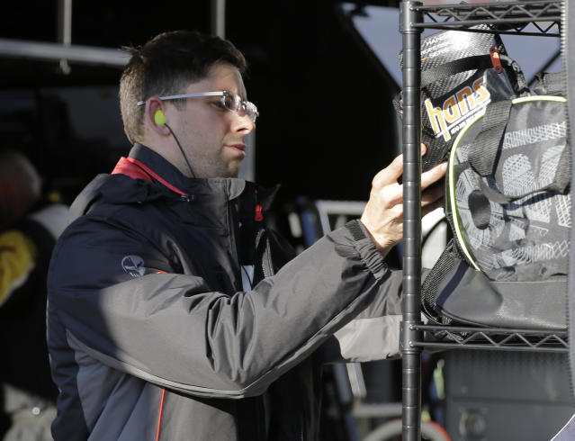 Jordan Taylor stores his gear after his turn to drive the Corvette C8.R car during the Rolex 24 hour auto race at Daytona International Speedway, Sunday, Jan. 26, 2020, in Daytona Beach, Fla. (AP Photo/Terry Renna)