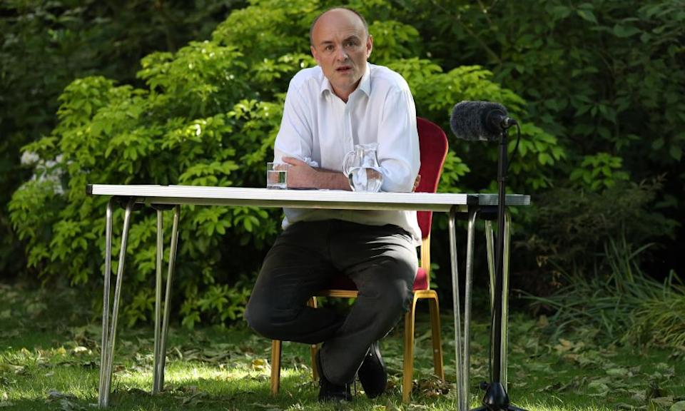 Dominic Cummings seated behind a table in the Rose Garden at 10 Downing Street
