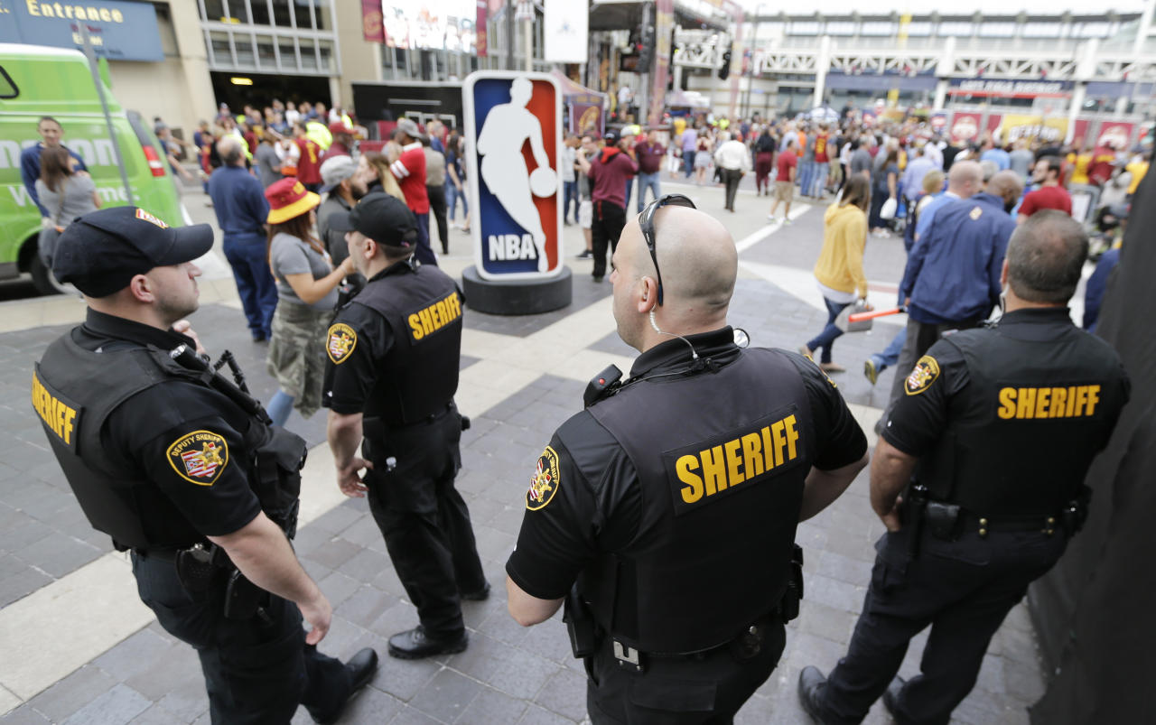 <p> Sheriff's Deputies keep watch on fans as they enter Quicken Loans Arena for Game 4 of the NBA basketball Eastern Conference finals between the Boston Celtics and the Cleveland Cavaliers, Tuesday, May 23, 2017, in Cleveland. Security was at a heightened at the game fans after Monday's suicide bombing that killed over a dozen people at a Manchester, England, arena (AP Photo/Tony Dejak) </p>