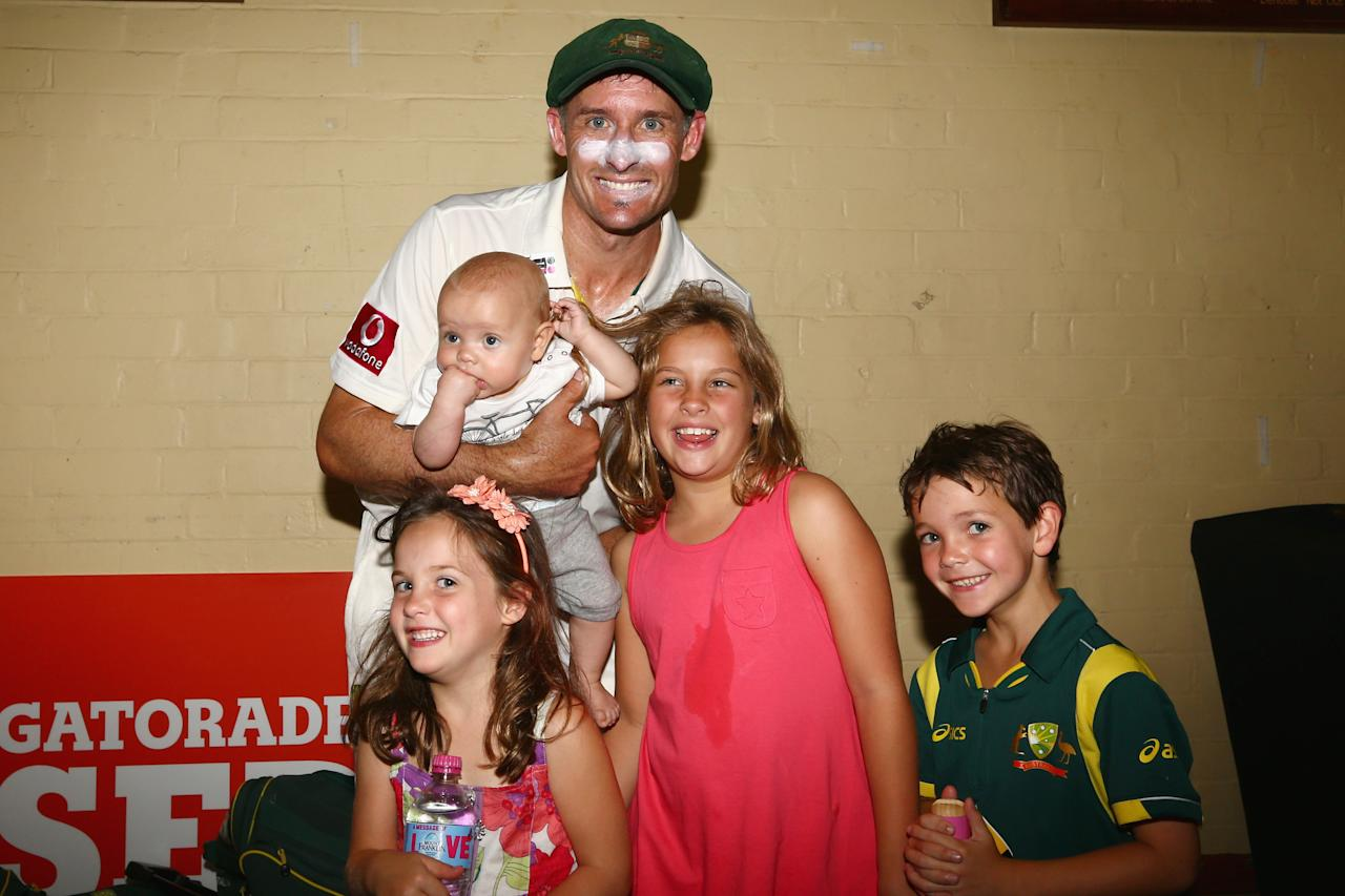 SYDNEY, AUSTRALIA - JANUARY 06:  Michael Hussey of Australia poses in the change room with his children Molly, Oscar (being held) Jasmin and William after his retirement from international cricket after day four of the Third Test match between Australia and Sri Lanka at Sydney Cricket Ground on January 6, 2013 in Sydney, Australia.  (Photo by Mark Kolbe/Getty Images)