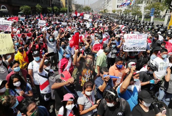 People react after Peru's interim President Manuel Merino announced his resignation, in Lima