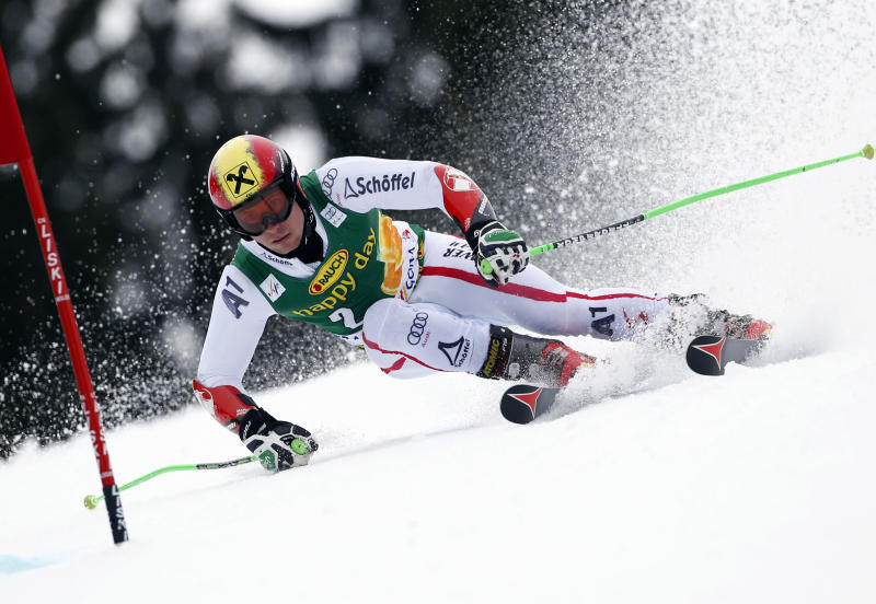 Austria's Marcel Hirscher passes a gate during the first run of an alpine ski, men's World Cup giant slalom, in Kranjska Gora, Slovenia, Saturday, March 9, 2013. (AP Photo/Alessandro Trovati)