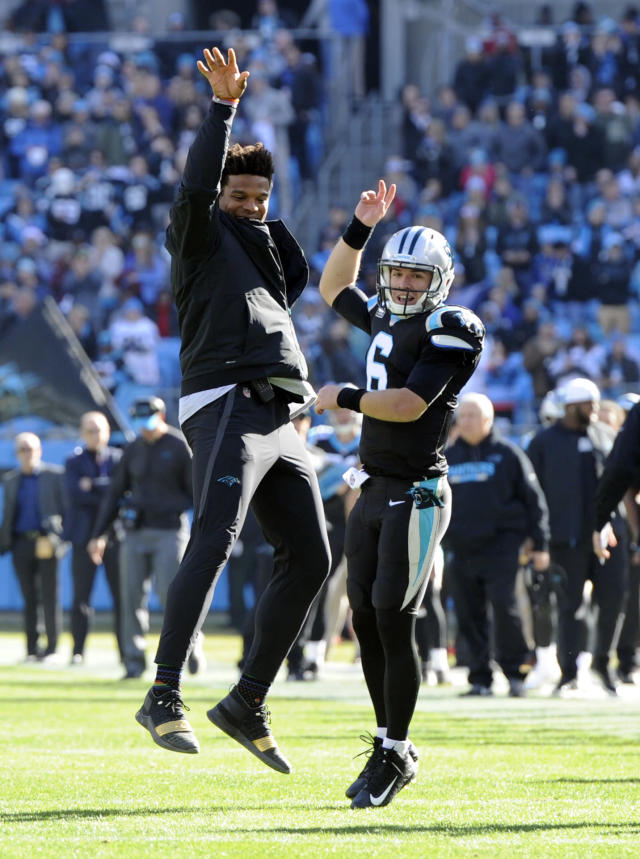 Carolina Panthers' Cam Newton celebrates with Taylor Heinicke (6) after Heinicke's touchdown pass against the Atlanta Falcons during the first half of an NFL football game in Charlotte, N.C., Sunday, Dec. 23, 2018. (AP Photo/Mike McCarn)