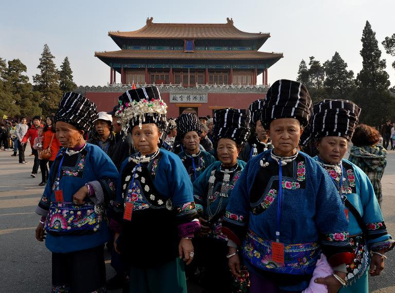 Miao minority tourists from China's Hunan province leave the Forbidden City in Beijing, on March 19, 2014