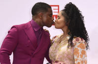 Kirk Franklin, left, and Tammy Collins kiss as they arrive at the BET Awards on Sunday, June 27, 2021, at the Microsoft Theater in Los Angeles. (Photo by Jordan Strauss/Invision/AP)