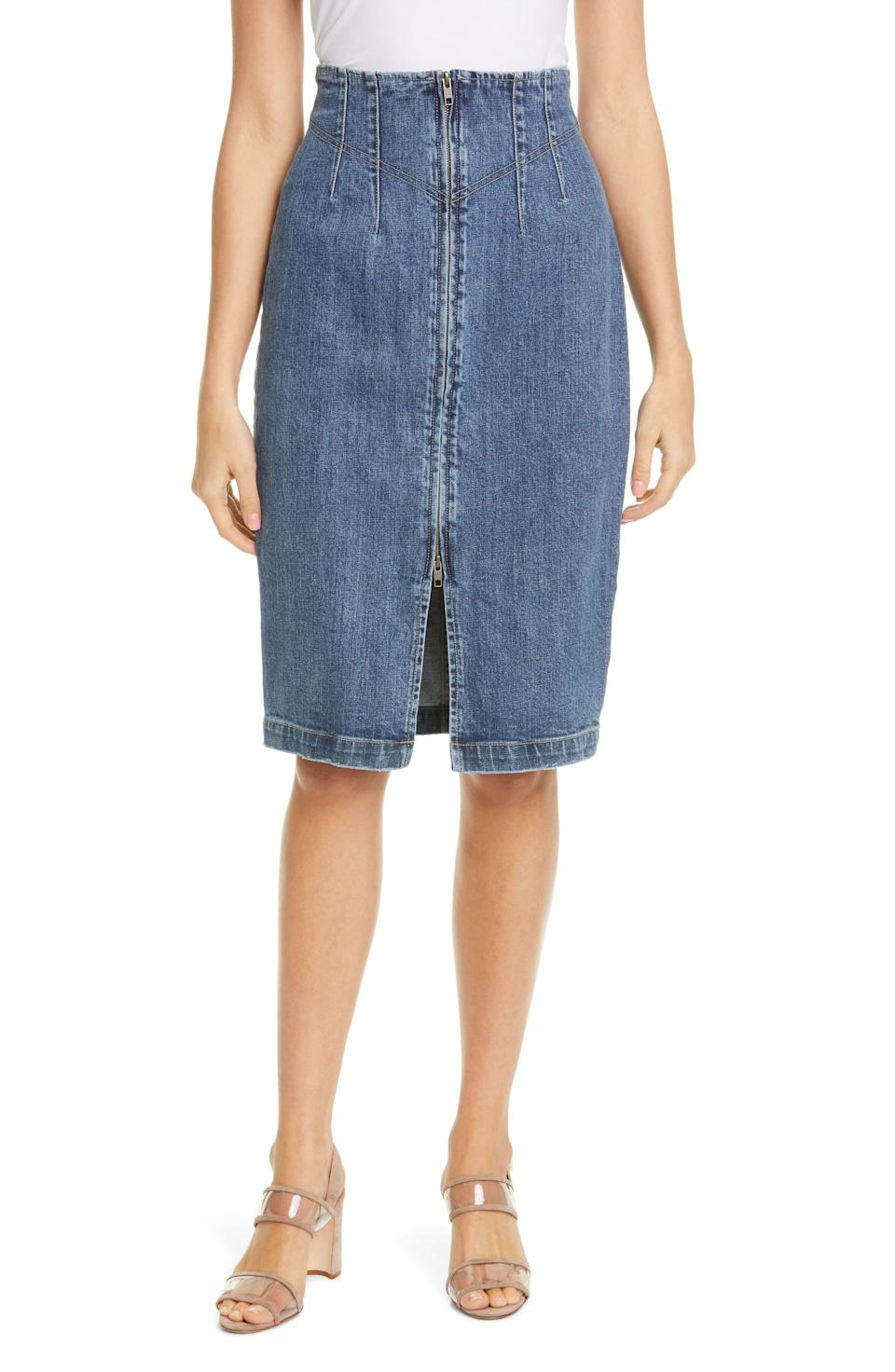 """<p><strong>LA VIE REBECCA TAYLOR</strong></p><p>nordstrom.com</p><p><strong>$150.00</strong></p><p><a href=""""https://go.redirectingat.com?id=74968X1596630&url=https%3A%2F%2Fshop.nordstrom.com%2Fs%2Fla-vie-rebecca-taylor-denim-skirt%2F5577196&sref=https%3A%2F%2Fwww.marieclaire.com%2Ffashion%2Fstreet-style%2Fg32046163%2Fbest-denim-skirts%2F"""" rel=""""nofollow noopener"""" target=""""_blank"""" data-ylk=""""slk:Shop It"""" class=""""link rapid-noclick-resp"""">Shop It</a></p><p>We love the front zipper on this feminine denim skirt. Wear it with a silk blouse tucked in to show off the shaped waistline. </p>"""