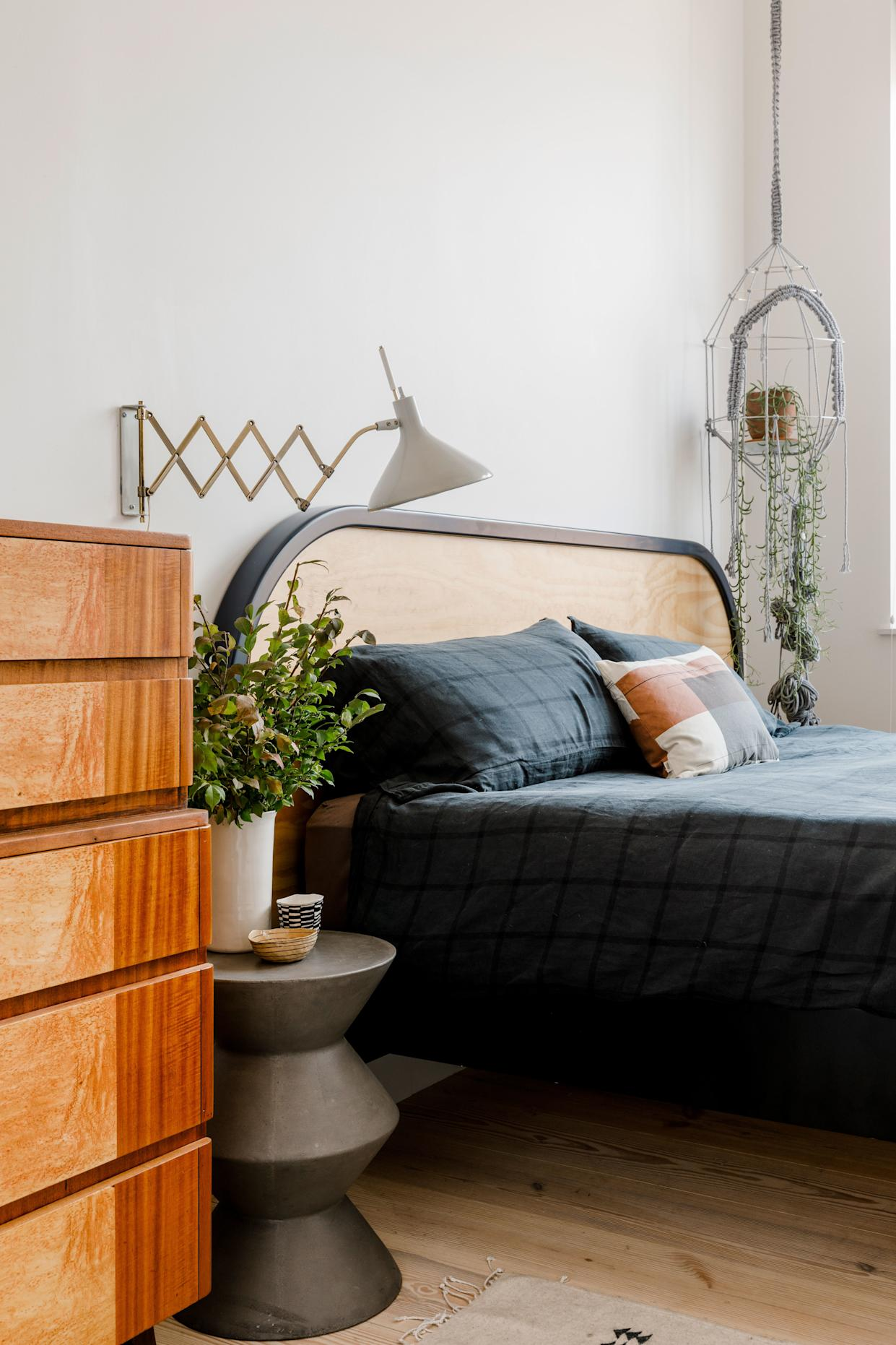 """<div class=""""caption""""> The lamp in <a href=""""https://www.architecturaldigest.com/story/this-designers-bed-stuy-apartment-is-meant-for-gatherings?mbid=synd_yahoo_rss"""" rel=""""nofollow noopener"""" target=""""_blank"""" data-ylk=""""slk:Matthew Stewart's"""" class=""""link rapid-noclick-resp"""">Matthew Stewart's</a> bedroom used to belong to his grandparents, but it still looks good and works great too. </div> <cite class=""""credit"""">Photo: Max Burkhalter</cite>"""