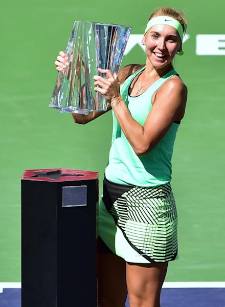 Elena Vesnina of Russia lifts the trophy after defeating compatriot Svetlana Kuznetsova in the women's singles final at the WTA Indian Wells Masters on March 19, 2017