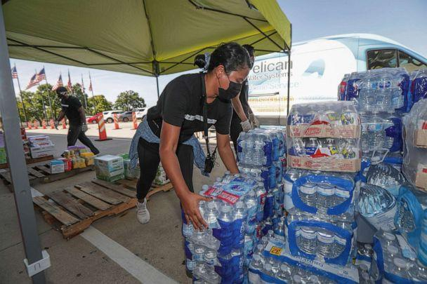 PHOTO: A Lakewood Church staff member organizes donated items collected for East Texas & Louisiana residents who were affected by Hurricane Laura, Aug. 27, 2020, in Houston. (Elizabeth Conley/AP, FILE)
