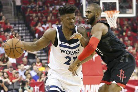 Apr 25, 2018; Houston, TX, USA; Minnesota Timberwolves guard Jimmy Butler (23) drives against Houston Rockets guard Chris Paul (3) in the second half in game five of the first round of the 2018 NBA Playoffs at Toyota Center. Mandatory Credit: Thomas B. Shea-USA TODAY Sports