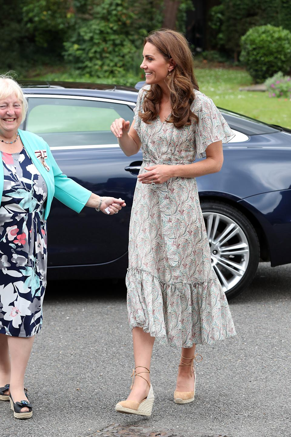 """The Duchess of Cambridge wore a paisley print tea dress by <a href=""""https://ridleylondon.com/collections/dresses-1/products/virginia-midi-3"""" rel=""""nofollow noopener"""" target=""""_blank"""" data-ylk=""""slk:Ridley London"""" class=""""link rapid-noclick-resp"""">Ridley London </a>with her Castaner 'Cabrina' espadrille wedges and her <a href=""""https://fave.co/2NfCY8B"""" rel=""""nofollow noopener"""" target=""""_blank"""" data-ylk=""""slk:Catherine Zoraida earrings"""" class=""""link rapid-noclick-resp"""">Catherine Zoraida earrings</a>. [Photo: Getty]"""