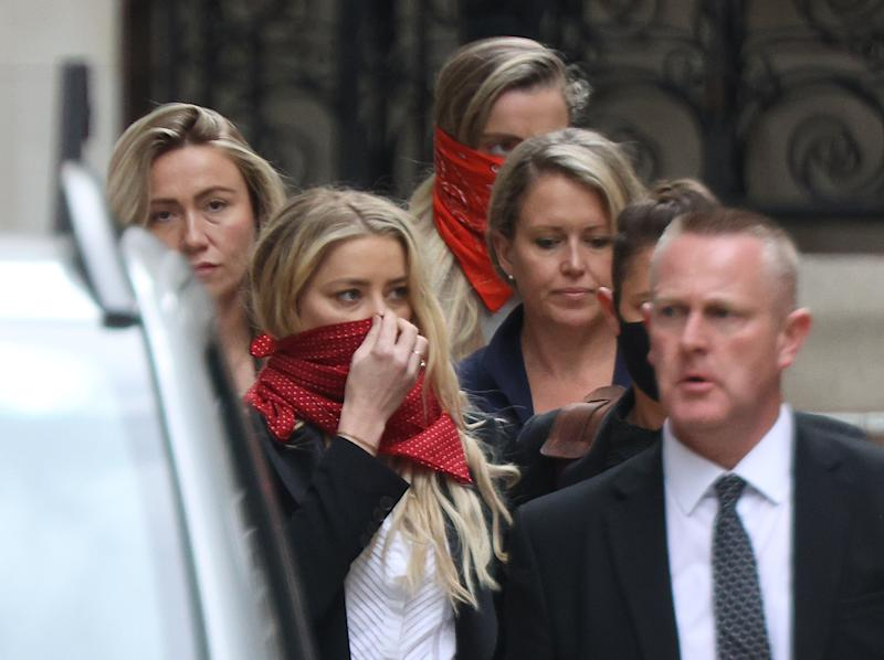 Actress Amber Heard (centre left) leaves the High Court in London during a hearing in Johnny Depp's libel case against the publishers of The Sun and its executive editor, Dan Wootton.
