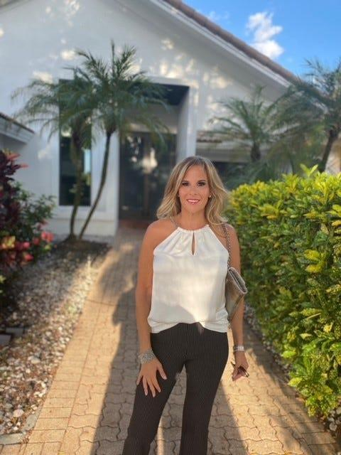 Lisa Sklar outside her new home in Boca Raton, Florida. Sklar moved from Chappaqua, New York to Florida during the pandemic.