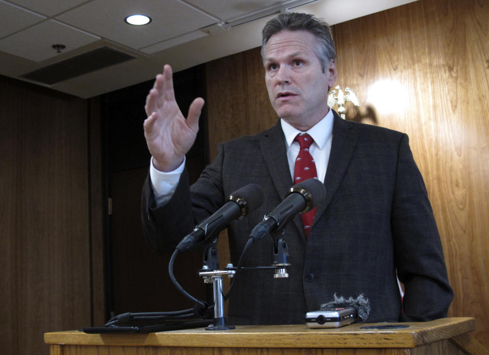 Alaska Gov. Mike Dunleavy speaks to reporters on Wednesday, Feb. 19, 2020, in Juneau, Alaska. Dunleavy has proposed giving Alaskans an additional roughly $1,300 from the state's oil wealth fund on top of the roughly $1,600 they received last fall that he says in keeping with a formula in state law. The formula has not been followed in recent years amid a budget deficit. (AP Photo/Becky Bohrer)