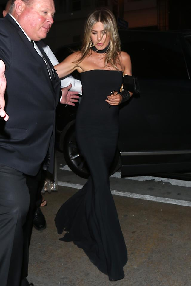 <p>Jennifer Aniston arrived at the engagement party for Gwyneth Paltrow and her Hollywood producer fiancé, Brad Falchuk, wearing a floor length black gown with choker detail. </p>