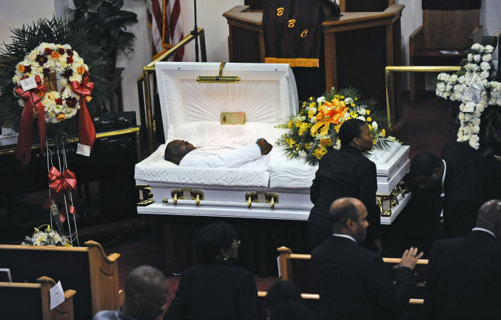 FILE - In this July 23, 2014, file photo, Eric Garner's body lies in a casket during his funeral at Bethel Baptist Church in the Brooklyn borough of New York. New York Attorney General Letitia James' inability to secure charges against Rochester police officers shown on video holding Daniel Prude to the pavement until he stopped breathing shows the difficulty in prosecuting officers who use deadly force. (Julia Xanthos/New York Daily News via AP, Pool, File)