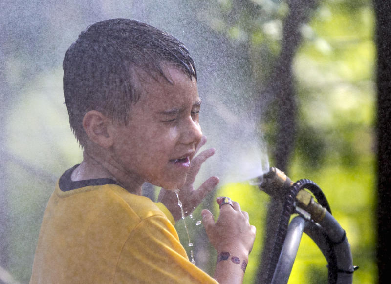 <p>               FILE - This July 6, 2012 file photo shows six-year-old Alexander Merrill of Sioux Falls, S.D., cooling off in a cloud of mist at the Henry Doorly Zoo in Omaha, Neb., as temperatures reached triple digits. Federal meteorologists say America was deep fried in 2012, becoming the hottest year on record by far. The National Climatic Data Center in Ashville, N.C., calculates that the average U.S. temperature in 2012 was 55.32 degrees Fahrenheit. That's a full degree warmer than the previous record of 1998. Normally, records are broken by about a tenth of a degree. (AP Photo/Nati Harnik, File)