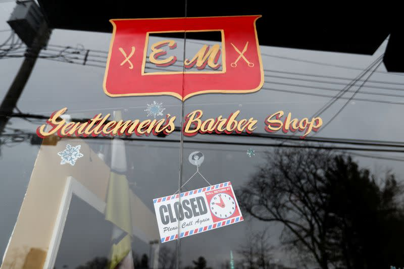 A closed barber shop is seen during the coronavirus outbreak in New Rochelle New York
