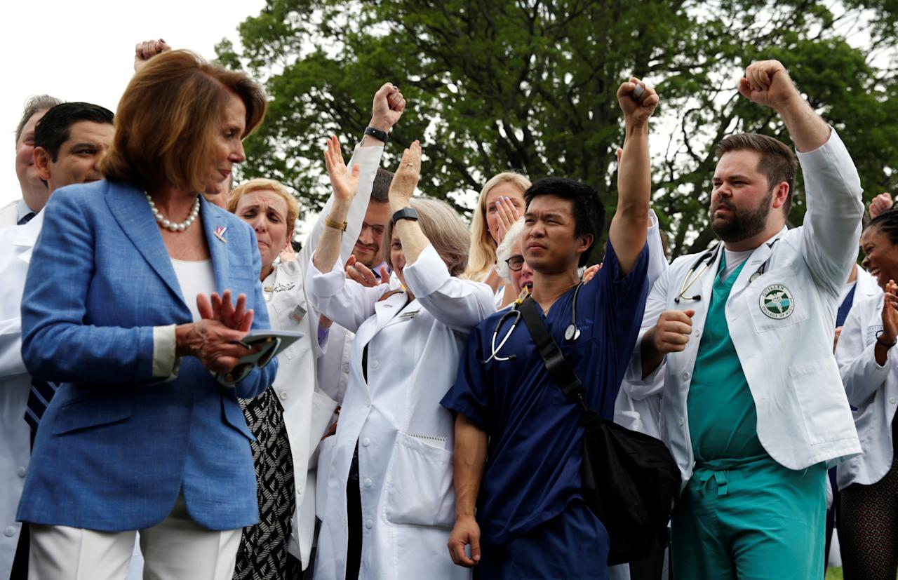 House of Representatives Democratic leader Nancy Pelosi and healthcare workers react to remarks during an event protesting proposed Republican healthcare legislation at the U.S. Capitol in Washington, U.S. June 22, 2017.  REUTERS/Kevin Lamarque