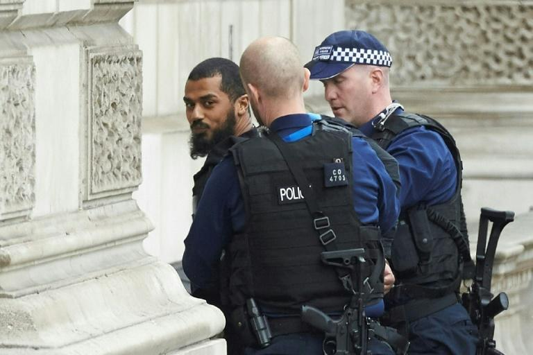London police say an anti-terror raid in the city was unrelated  to the earlier arrest of a man armed with knives close to the Houses of Parliament