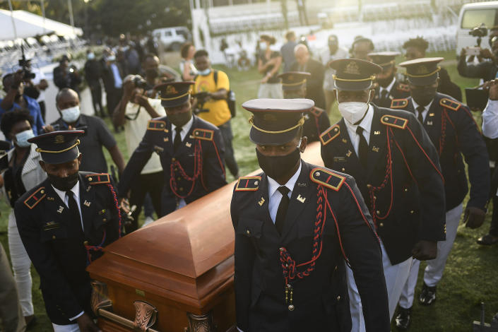 Police carry the coffin of slain Haitian President Jovenel Moise at the start of the funeral at his family home in Cap-Haitien, Haiti, early Friday, July 23, 2021. Moise was assassinated at his home in Port-au-Prince on July 7. (AP Photo/Matias Delacroix)