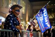 A supporter of U.S. President Donald Trump dressed with the U.S. flag colors waits for the election results as votes continue to be counted following the 2020 U.S. presidential election, in Philadelphia