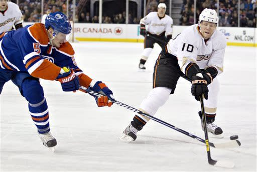 Anaheim Ducks' Corey Perry (10) battles with against Edmonton Oilers' Ladislav Smid during the first period of their NHL hockey game in Edmonton, Alberta, Sunday, April 21, 2013. (AP Photo/The Canadian Press, Jason Franson)