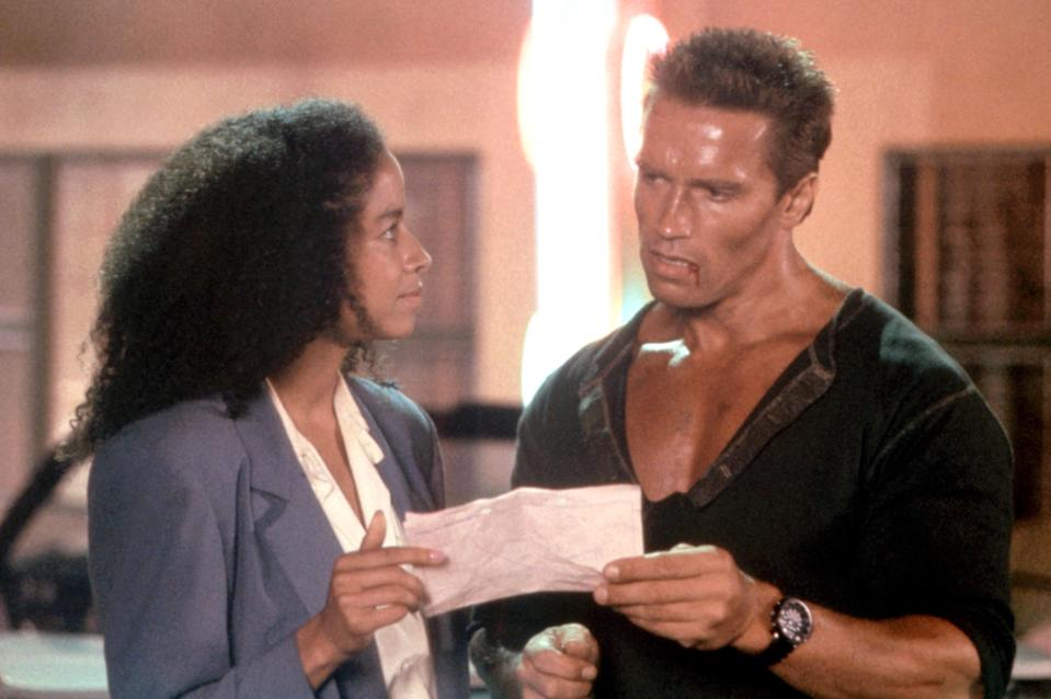 Rae Dawn Chong and Arnold Schwarzenegger had a love scene in an early version of the action favorite 'Commando' (Photo: 20th Century Fox Film Corp.)