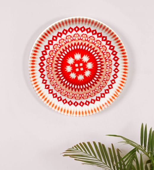 "From Indonesia to India, everyone loves a good Ikat weave like this digital interpretation on the <a href=""https://fave.co/37SmVp2"" rel=""nofollow noopener"" target=""_blank"" data-ylk=""slk:bone china wall plate by Kolorobia"" class=""link rapid-noclick-resp""><strong>bone china wall plate by Kolorobia</strong></a>. <em>Rs.1,489 on offer. </em><a href=""https://fave.co/37SmVp2"" rel=""nofollow noopener"" target=""_blank"" data-ylk=""slk:Flash sale!"" class=""link rapid-noclick-resp""><strong>Flash sale!</strong></a>"