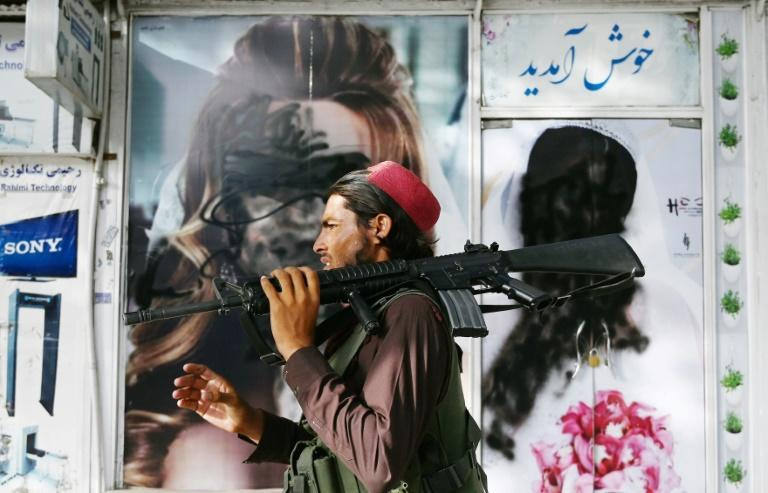 Images of female models on the streets of Kabul have been defaced since the Taliban's takeover (AFP/Wakil KOHSAR)