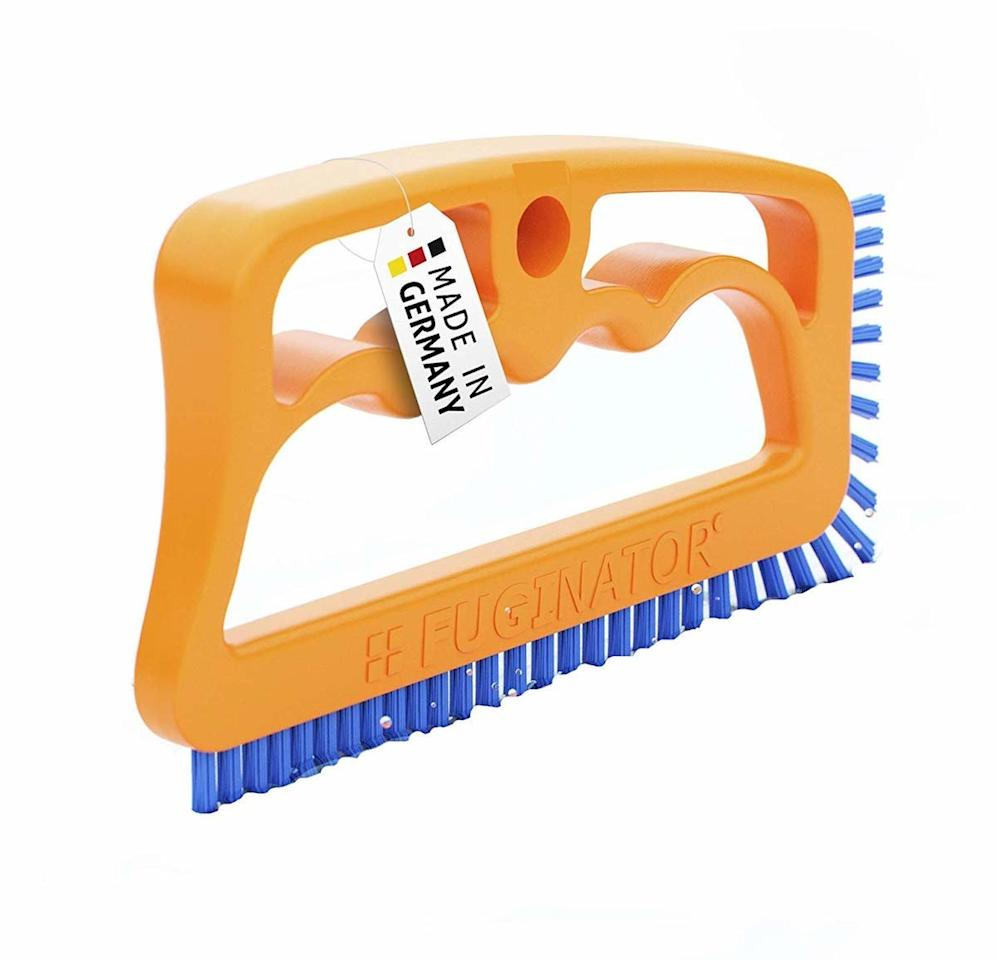 """<p>If you're using an old toothbrush to <a href=""""https://www.realsimple.com/home-organizing/how-to-clean-grout"""" target=""""_blank"""">de-gunk the grout</a> in your bathroom, upgrading to this specialized brush will save you time and elbow grease. The long, thin scrub brush can clean more grout at one time, making quick work of a time-consuming task. Bonus: the brush is also well-designed to clean the track of sliding glass doors. </p> <p><strong>To buy: </strong>$13, <a href=""""http://20&linkId=35e21d410ea0898bc703e6dc7fe94a15&language=en_US https://www.amazon.com/dp/B0099TJARM/ref=as_li_ss_tl?ie=UTF8&linkCode=ll1&tag=rshomecleaningtoolskholdefehrsept19-20&linkId=3a2890f8996d8c71ef1dbf55d9f3f162&language=en_US"""" target=""""_blank"""">amazon.com</a>. </p>"""