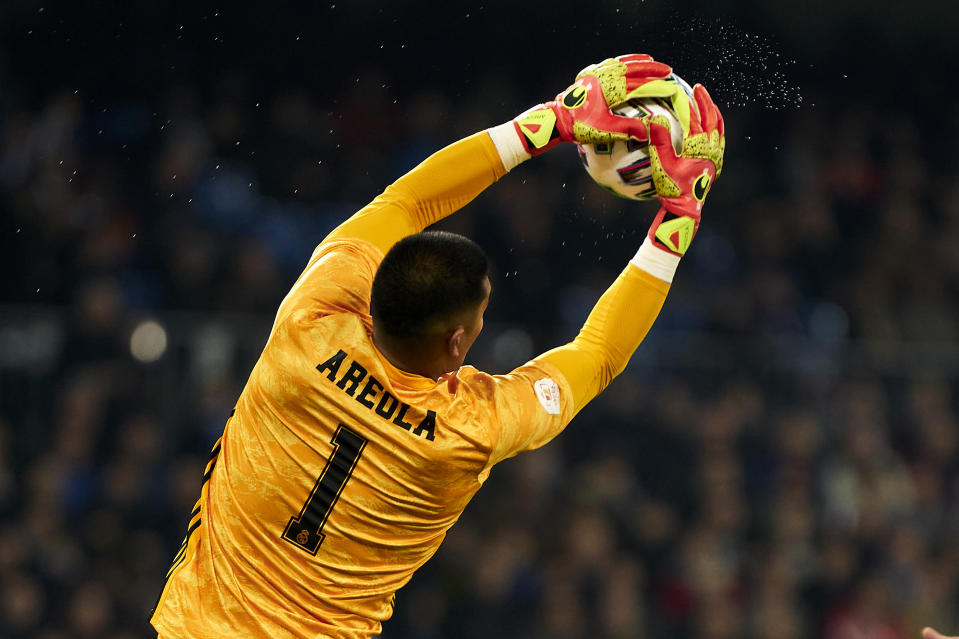 MADRID, SPAIN - FEBRUARY 06: Alphonse Areola of Real Madrid makes a save during the Copa del Rey match between Real Madrid and Real Sociedad at Estadio Santiago Bernabeu on February 6, 2020 in Madrid, Spain. (Photo by Perez Meca/MB Media/Getty Images)