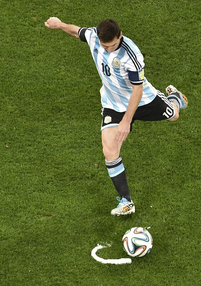 Argentina's Lionel Messi preforms a free kick during the World Cup semifinal soccer match between the Netherlands and Argentina at the Itaquerao Stadium in Sao Paulo, Brazil, Wednesday, July 9, 2014. (AP Photo/Francois Xavier Marit, Pool)