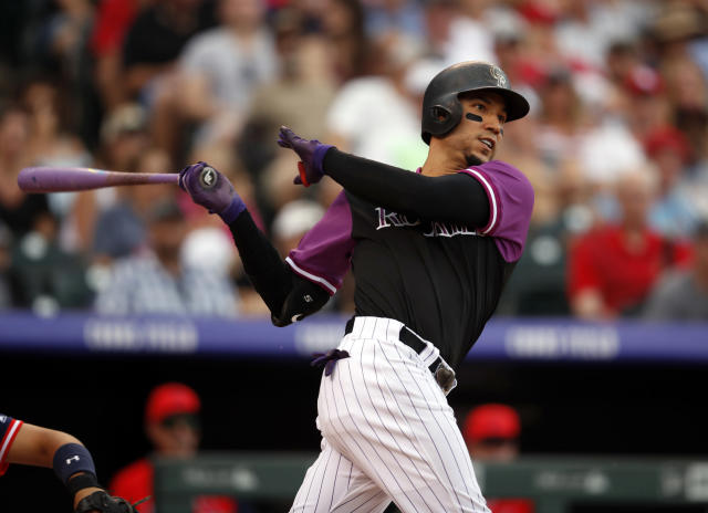 FLE - In this Aug. 26, 2018, file photo, Colorado Rockies right fielder Carlos Gonzalez bats in the eighth inning of a baseball game in Denver. The free-agent outfielder a minor league contract with the Cleveland Indians. If he makes Clevelands 40-man roster, he will get a $2 million contract in the majors, and can earn $1 million in performance bonuses. (AP Photo/David Zalubowski, File)
