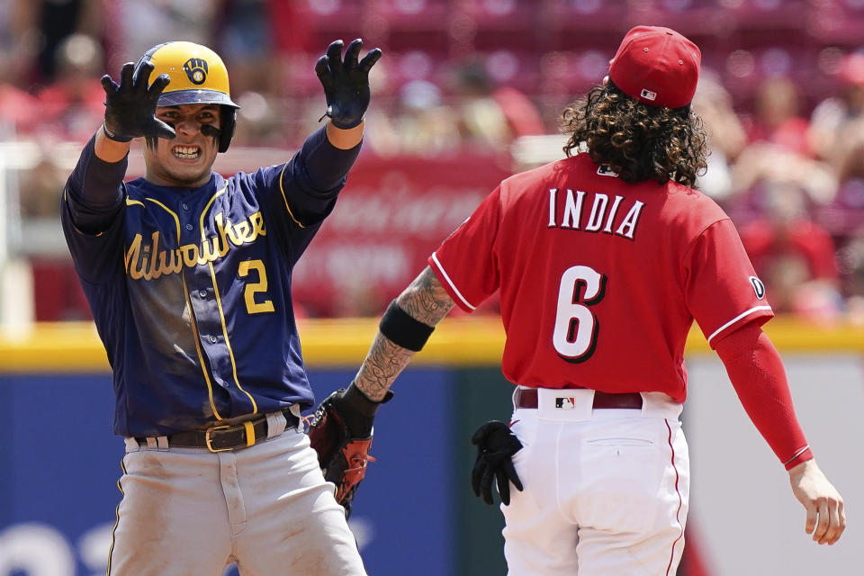 Milwaukee Brewers' Luis Urias (2) celebrates a play during the fifth inning of a baseball game against the Cincinnati Reds in Cincinnati, Sunday, July 18, 2021. (AP Photo/Bryan Woolston)