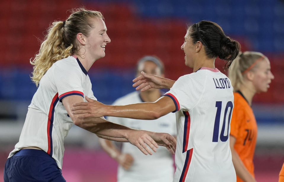 United States' Samantha Mewis, left, celebrates with teammate Carli Lloyd after scoring against Netherlands during a women's quarterfinal soccer match at the 2020 Summer Olympics, Friday, July 30, 2021, in Yokohama, Japan. (AP Photo/Silvia Izquierdo)