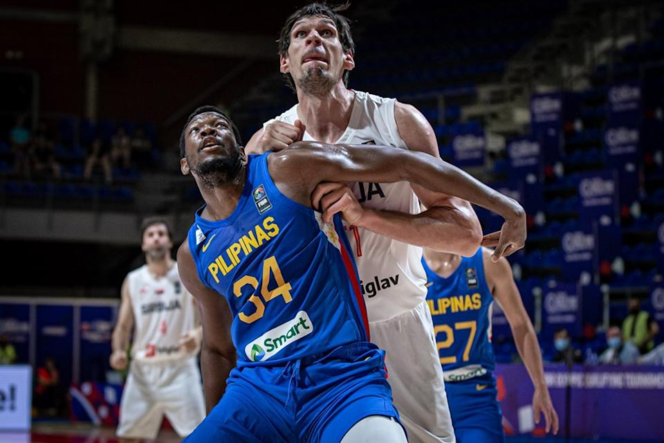 Ange Kouame and Boban Marjanovic fighting for position down low in the match between Philippines and Serbia. (Photo: FIBA Basketball)