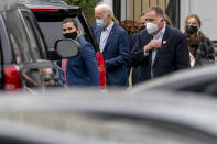 Democratic presidential candidate former Vice President Joe Biden leaves St. Joseph On the Brandywine Roman Catholic Church with his granddaughter Finnegan Biden, right, Sunday, Oct. 25, 2020, in Wilmington, Del. (AP Photo/Andrew Harnik)